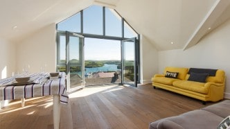 The living room at Lundy with it's beautiful views over salcombe estuary