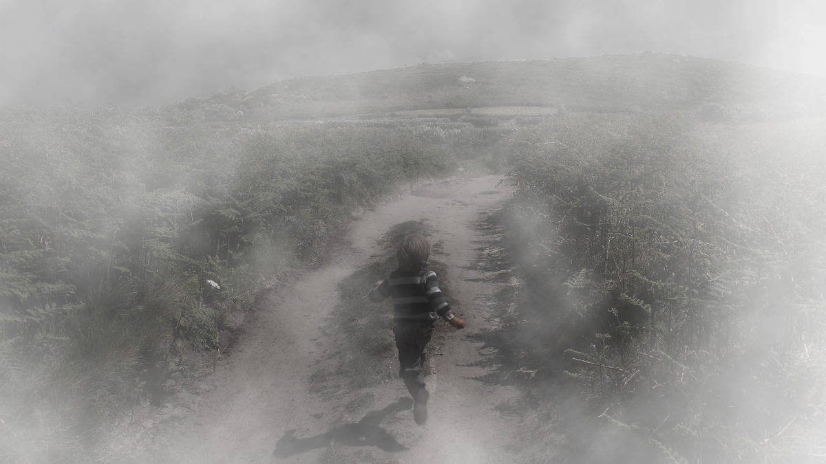 boy_running_into_the_misty-Moor
