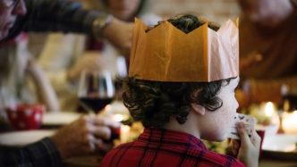 boy-wearing-christmas-cracker-crown