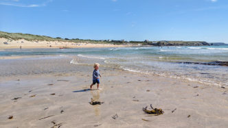 boy-running-across-Cornish-beach